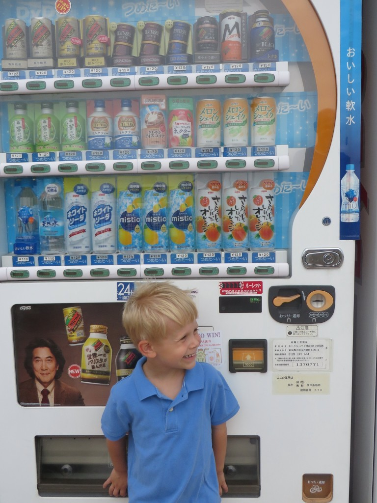 No pictures of the house yet, so here's one of Liam in front of a Japanese vending machine.